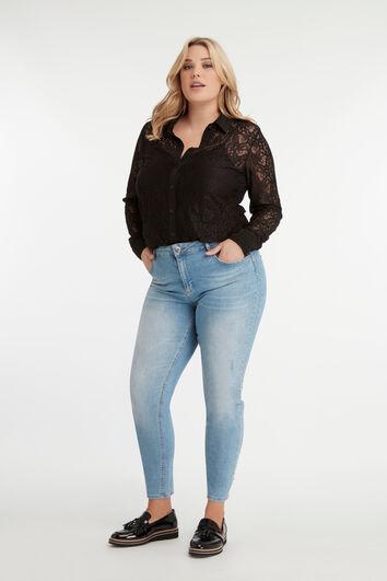 Jeans met rhinestones en studs